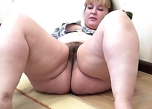 A chubby sweeping to a hairy pussy masturbates to a cucumber
