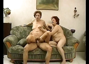 2 grandmas enjoy a clog added to his cock.